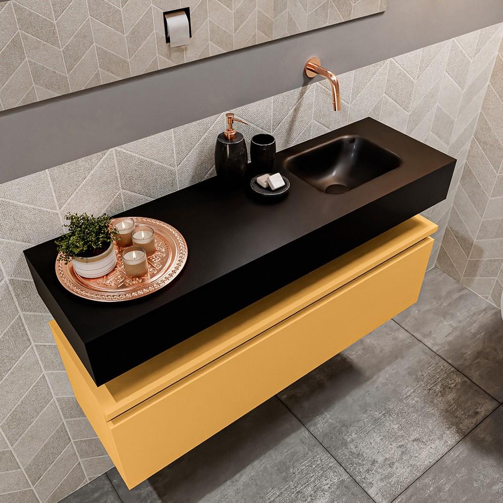 vrijhangende wastafel solid surface zwart met gele fonteinkast 1 lade